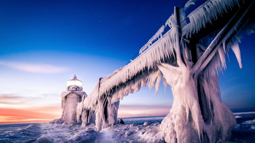 Ice covered St. Joseph north pier lighthouse in winter, Michigan, USA
