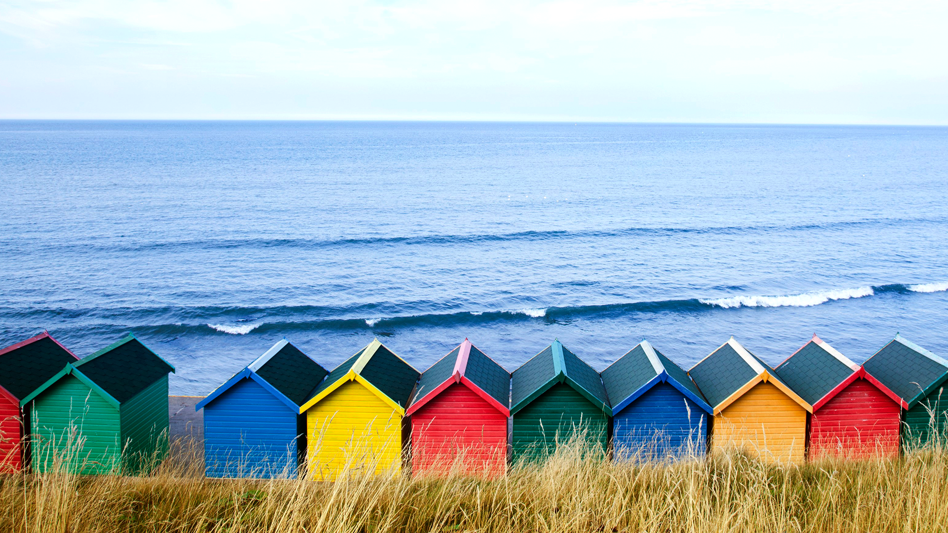 Colourful Beach Huts Along The Seafront North Yorkshire