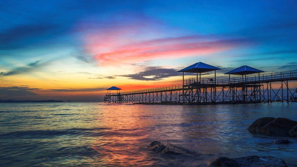 Sunset over jetty, Nongsa Beach, Montigo Resorts, Batam, Riau Islands, Indonesia