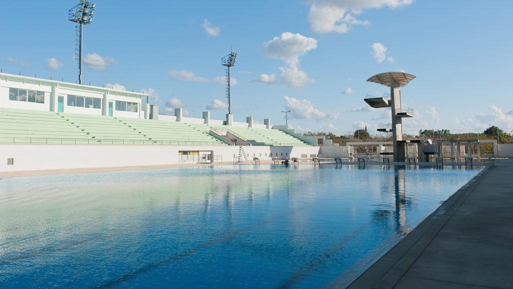Open air swimming pool with diving platform
