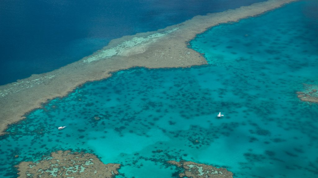 Floatplane on surface of waters of Great Barrier Reef, Airlie Beach, Queensland, Australia
