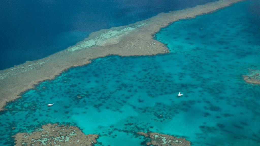 Floatplane on surface of waters of Great Barrier Reef, Airlie Beach, Queensland, Australia