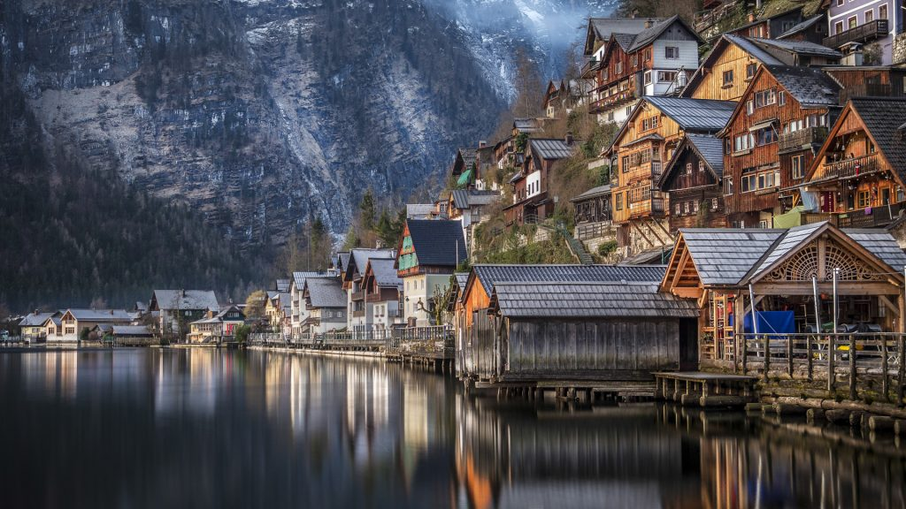 Traditional houses by river rover mountain, Hallstatt, Salzkammergut, Austria