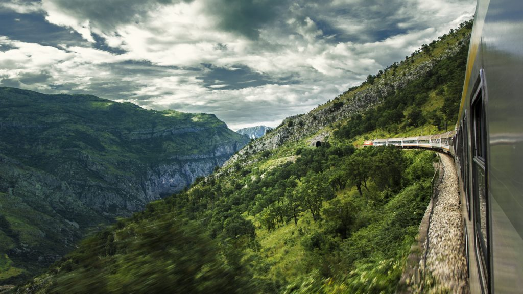 View from a moving train entering the Moraca canyon, Montenegro on a cloudy day