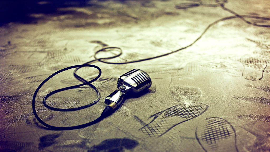 Retro microphone on floor with footprints
