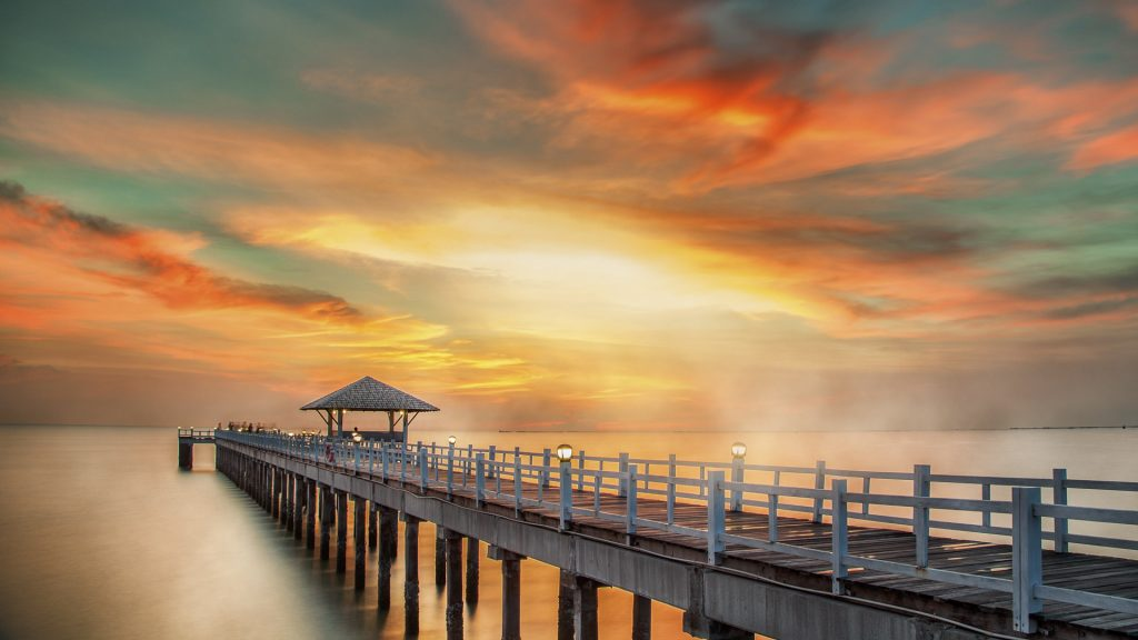 Wooden pier between sunset in Phuket, Thailand