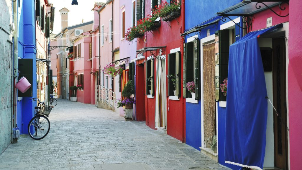 Colorful buildings in Burano island street, Venice, Italy