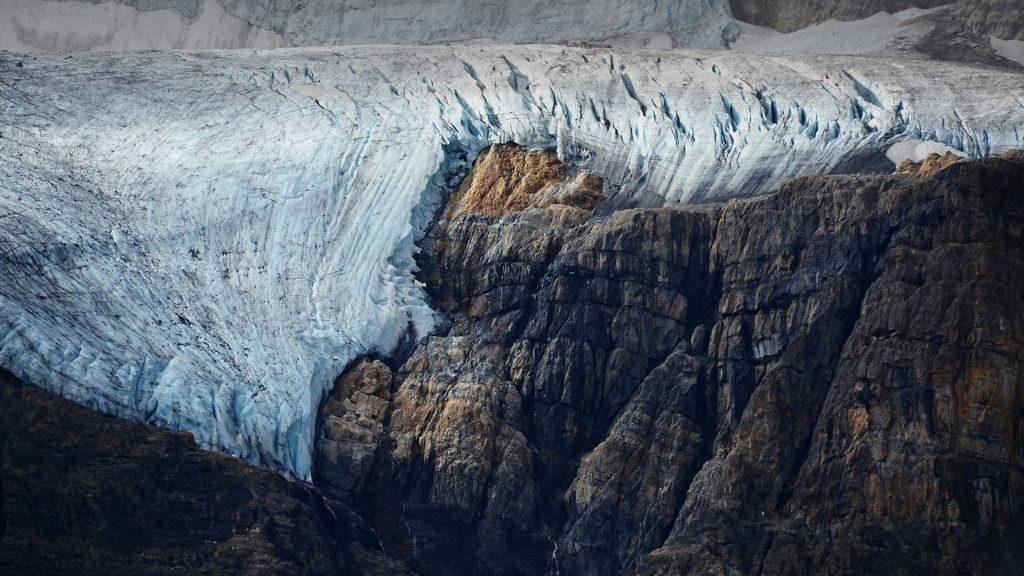 Cracked glacier at the edge of a cliff, Athabasca Glacier, Alberta, Canada