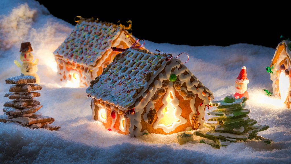 Small gingerbread cottage in winter at night