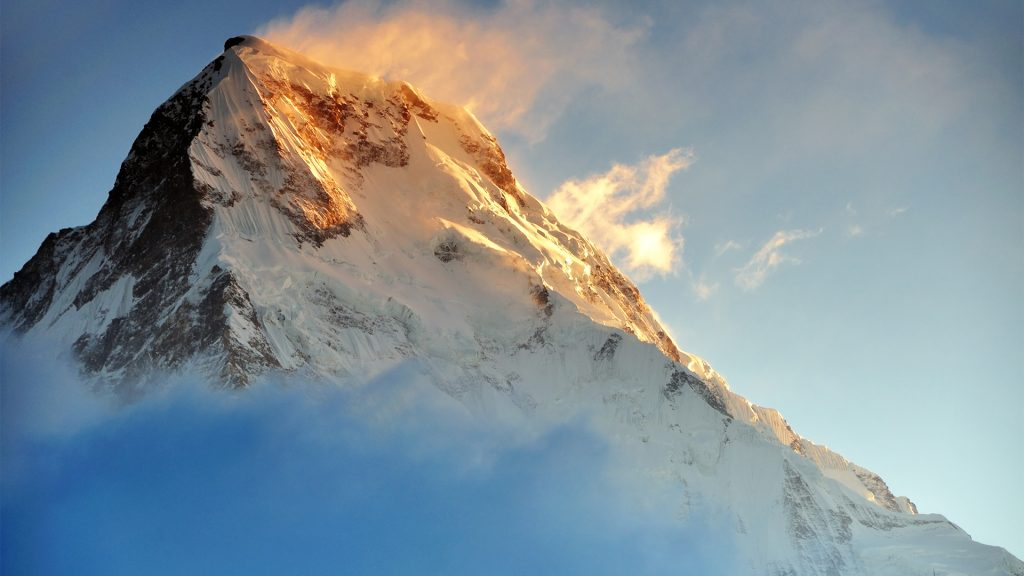 Sunrise light on Fish Tail or Machapuchare Mountain, Annapurna region, Nepal
