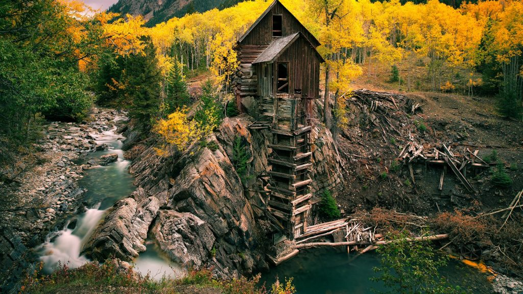 Abandoned old wooden mill near river cliff, Crystal, Colorado, USA