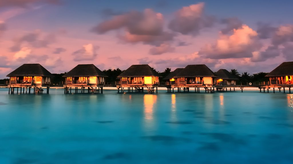Water bungalows with beautiful twilight sky and sea in Maldives