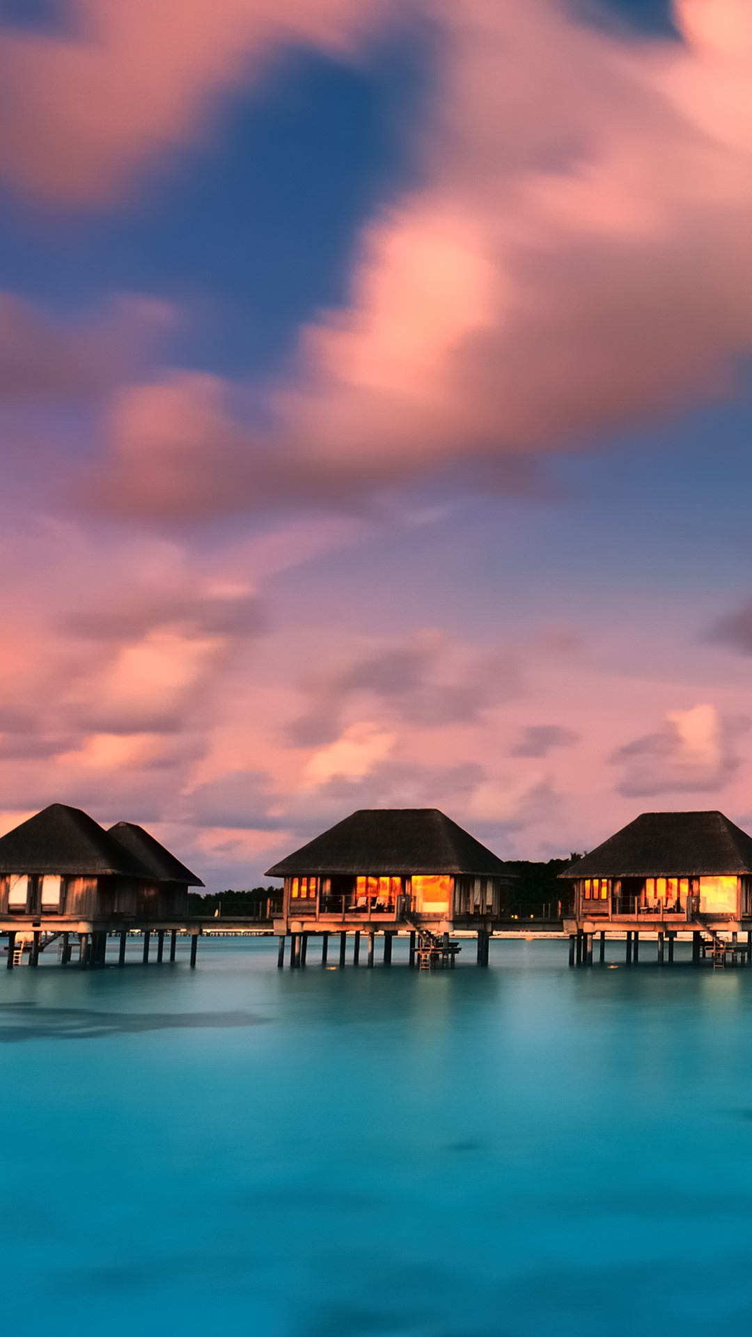 Water Bungalows With Beautiful Twilight Sky And Sea In