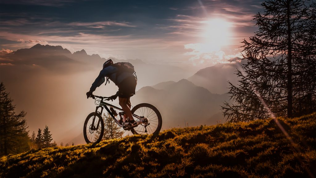 A mountain biker riding at sunset, Slovenia