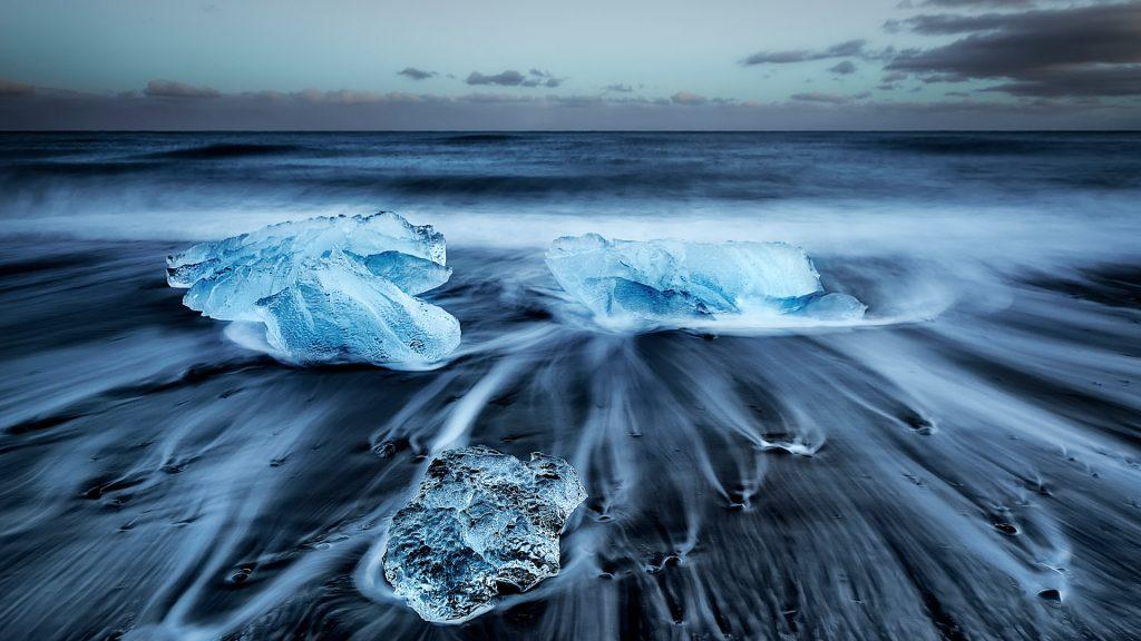Jökulsárlón Diamonds, volcanic black beach after sunset, Iceland
