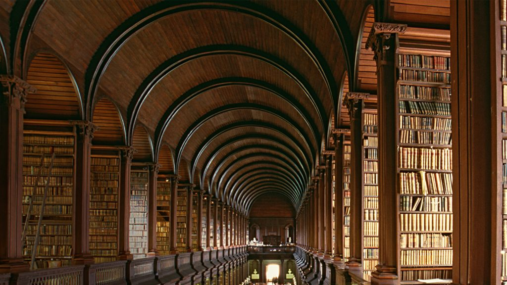 Old library, wisdom in old shelves and books, Trinity College Library, Dublin, Ireland