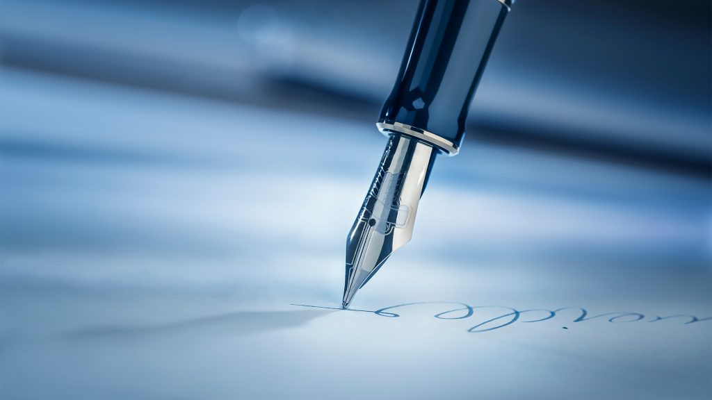 Signing a legal document with a fountain pen