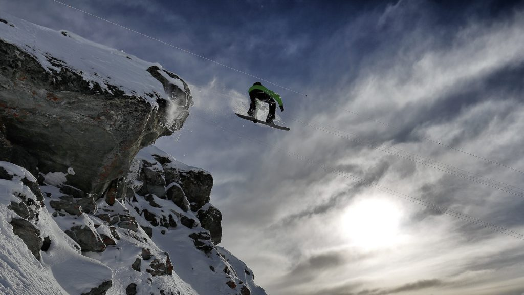 A snowboarder on Mont Gelé, Alps, Switzerland