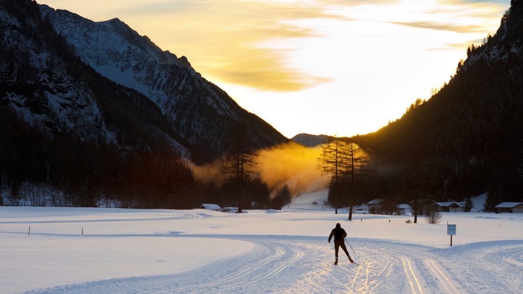 Cross-country skiing at sunset in the Alps, South-Tyrol, Italy