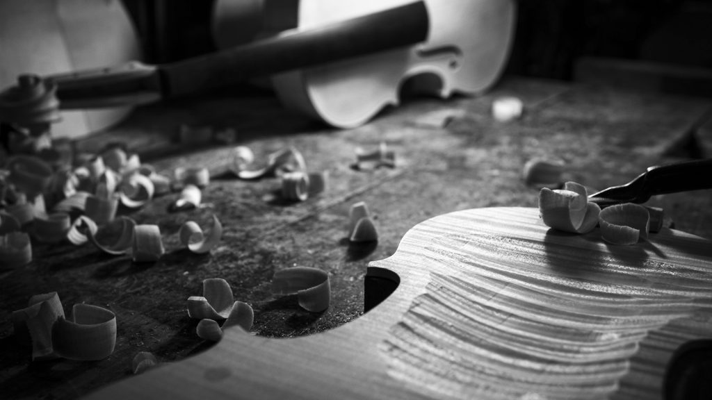 Detail of the violin woodcarving process
