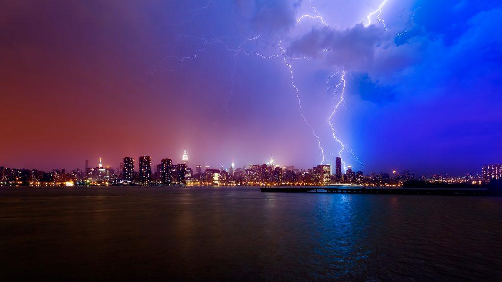 Lightning strike over New York City skyline, USA