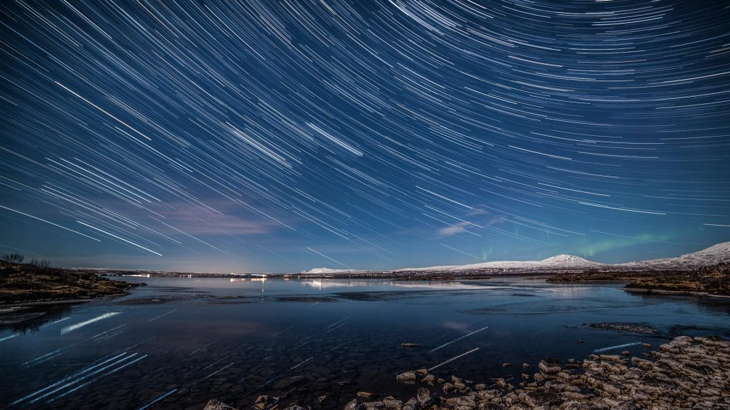 Stars trails and aurora borealis over Þingvellir (Thingvellir) national park, Iceland