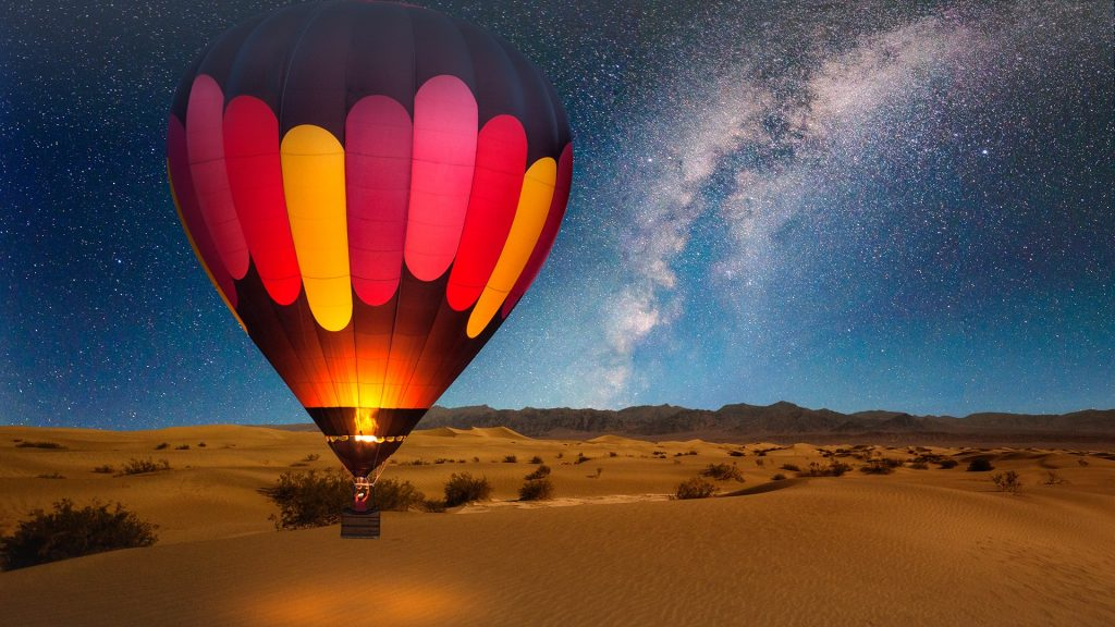 Hot air balloon over desert, Mesquite Dunes of Death Valley National Park, Califormia, USA