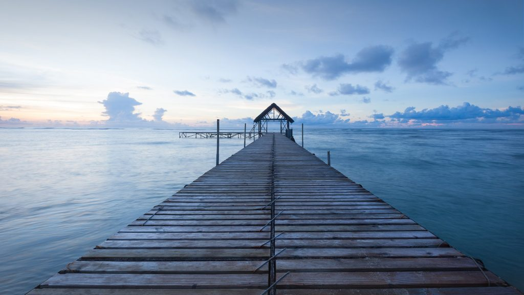 A pier extending into the Indian Ocean, Mauritius Island