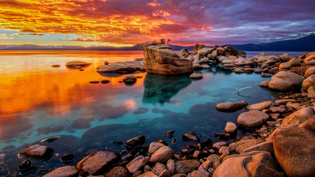 Candy colored skies sunset at shoreline of Lake Tahoe, Nevada, USA