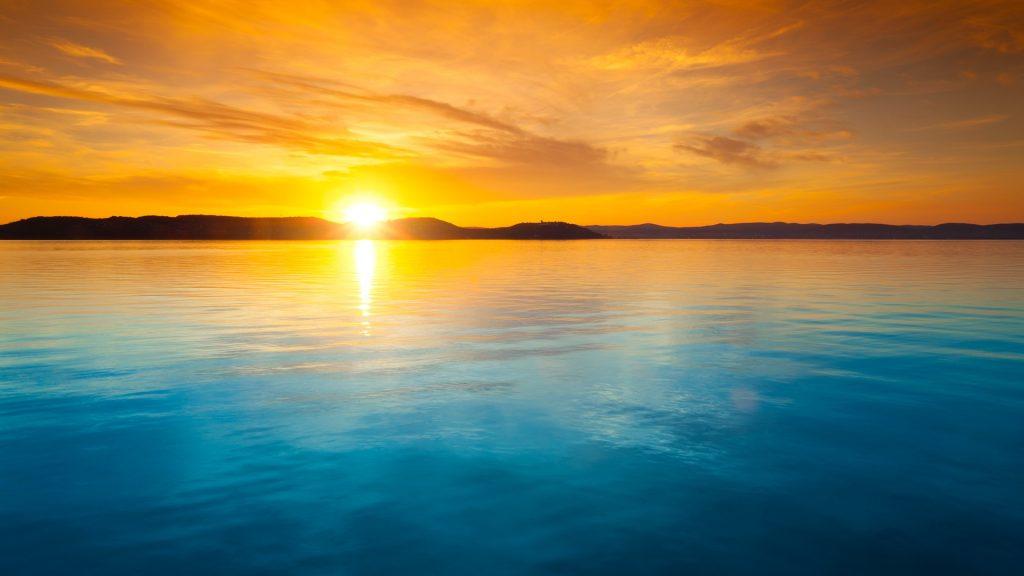 Sunset over water, Balaton lake, Hungary