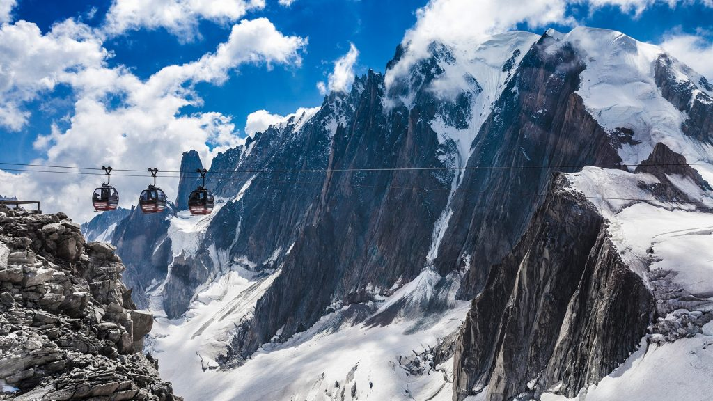 Cable cars over snow covered valley at Mont blanc, France