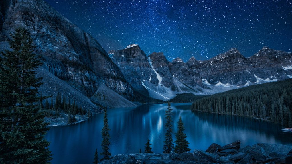 Moraine Lake at night, snowy landscape in the mountains, Canada