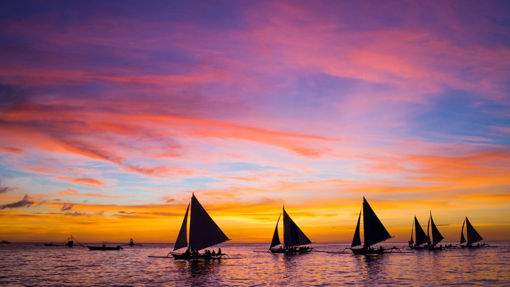 Sailing boats in the sea at sunset, Boracay, Philippines