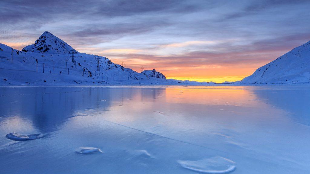 The colors of dawn of Lago Bianco, Bernina Pass, Graubunden, Swiss Alps, Switzerland