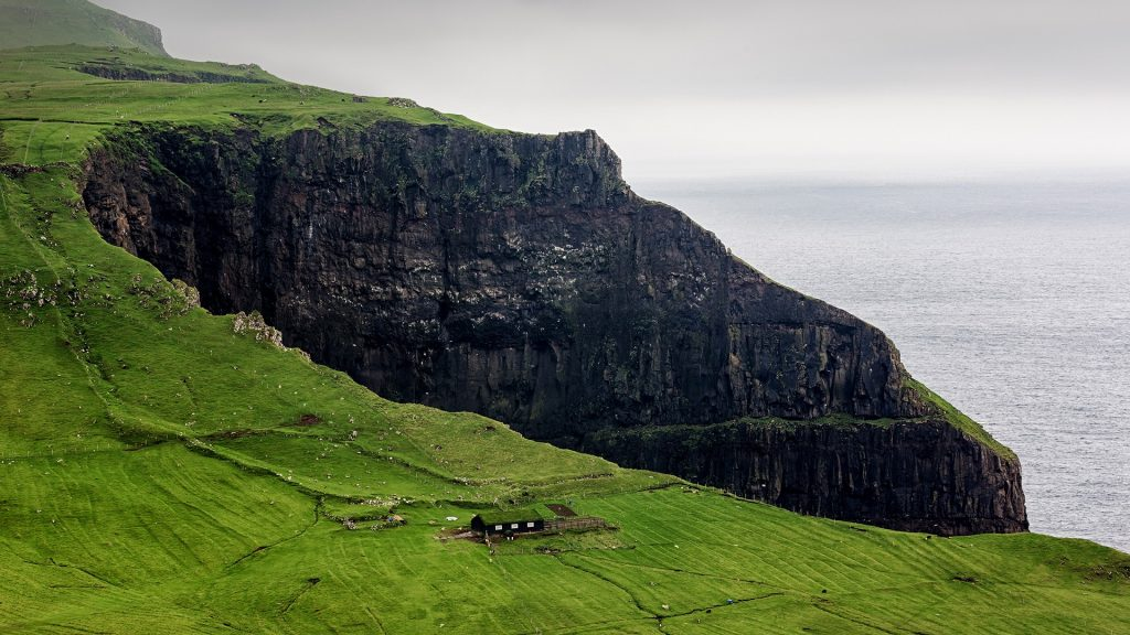 Farmhouse in dramatic surroundings on Faroe Islands