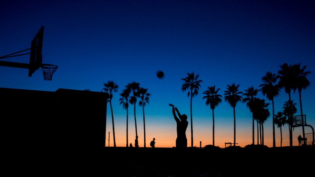 Shooting basketball, Venice Beach at sunset, Los Angeles, USA