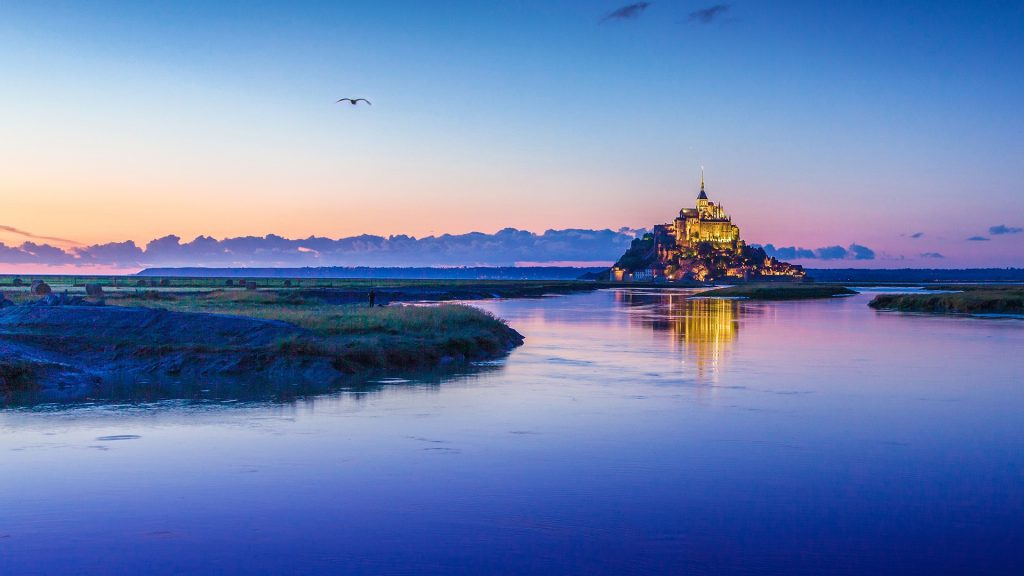 Le Mont Saint-Michel tidal island in twilight at dusk, Normandy, France