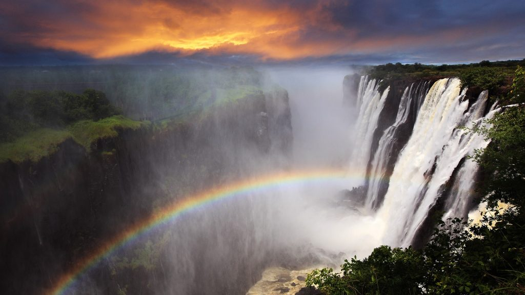 Victoria Falls sunset with rainbow, Livingstone, Zambia