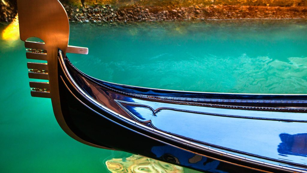 Close up of ornate gondola decoration on canal, Venice, Italy