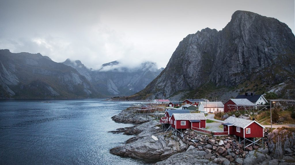 Houses by river and mountains against sky, Hamnøy, Moskenesøya, Lofoten Islands, Norway