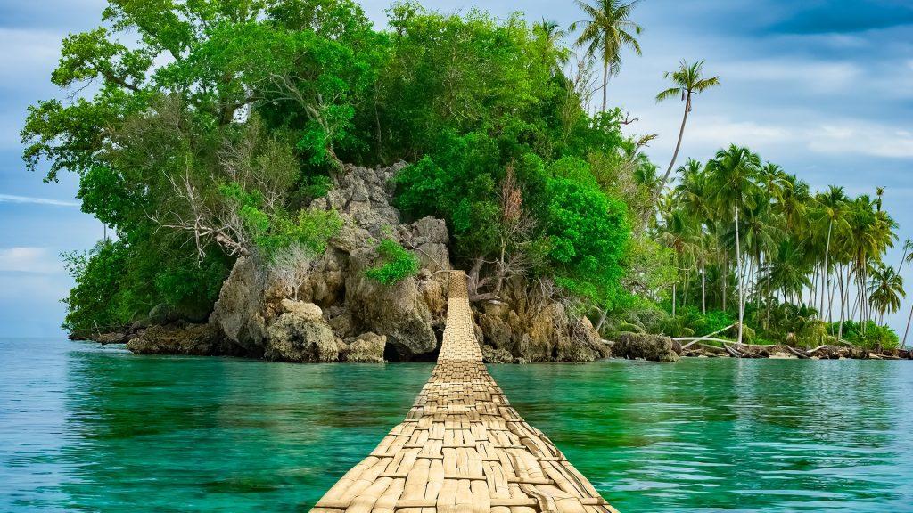 Bamboo pedestrian hanging bridge over sea to remote desert island, Banyak Archipelago, Indonesia