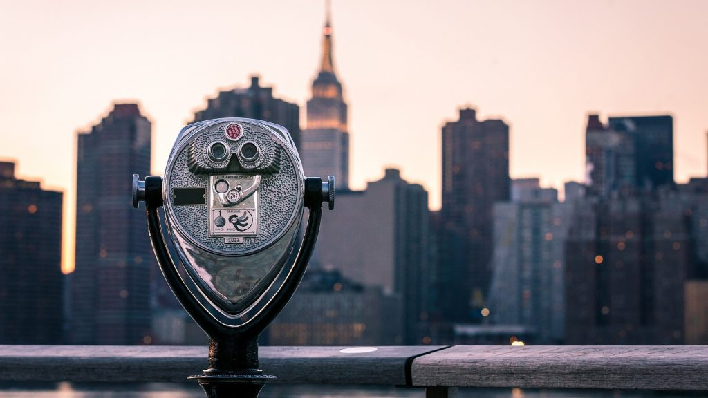 A coin-operated viewfinder pointed towards Manhattan and the Empire State Building, New York City, USA