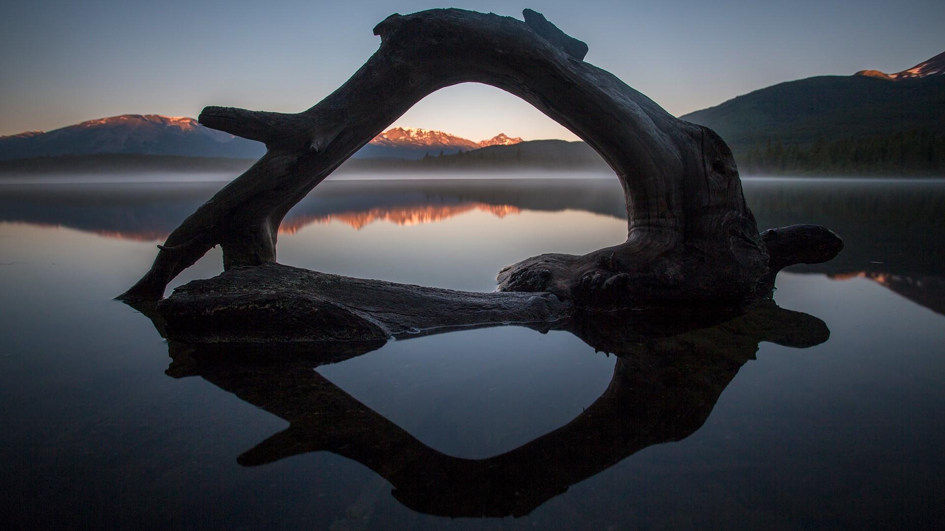 Scenic View Of Pyramid Lake During Sunrise Alberta
