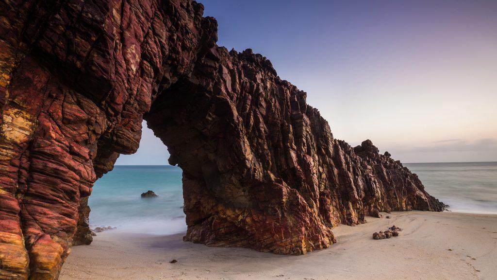 Pedra Furada rock formation on Jericoacoara beach, Brazil