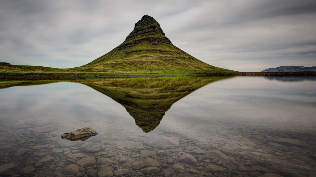 Kirkjufell mountain reflecting in calm waters, Snæfellsnes peninsula, Iceland