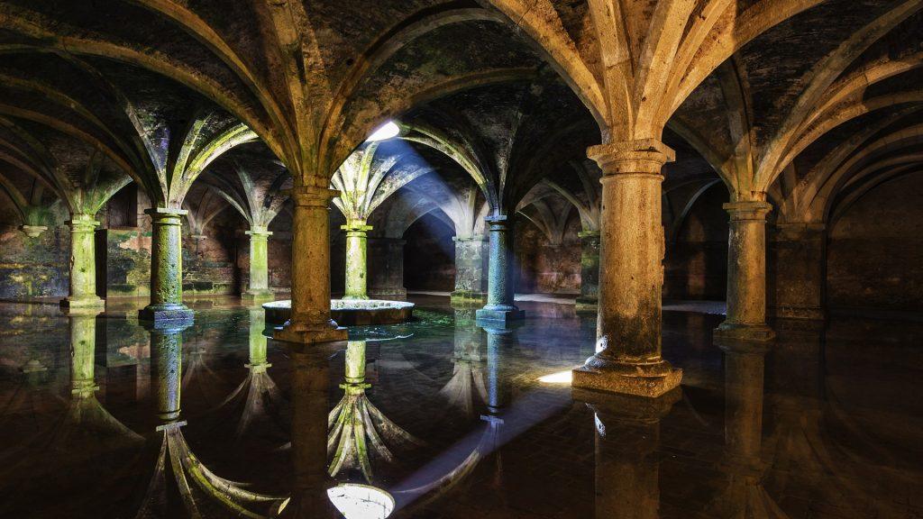 Columns Reflected In Portuguese Cistern Underground Water
