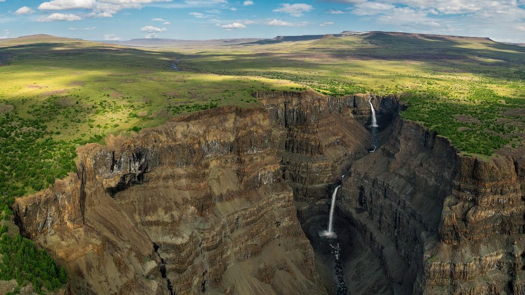 Waterfalls in deep canyon in Putorana Plateau, Siberia, Russia