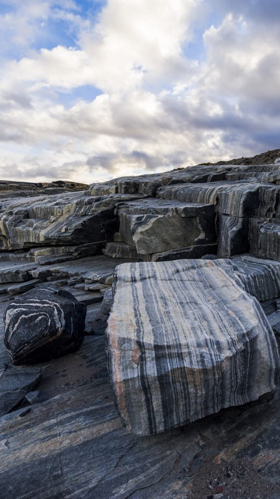 Striations carved into a bedrock by ice erosion as