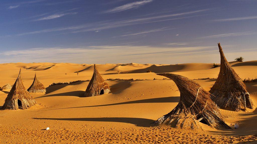 Straw huts on Sahara desert, Libya