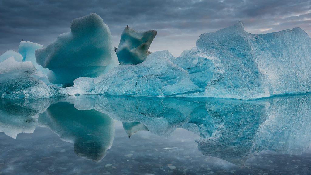 Icebergs melting in the midsummer night at Jökulsárlón, Iceland